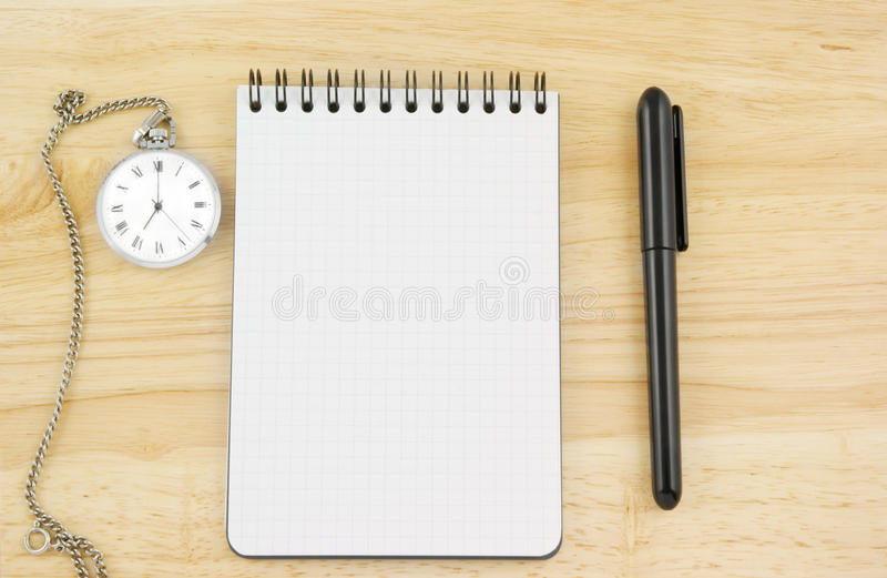 Pen, Watch And Blank Note Pad Stock Photos