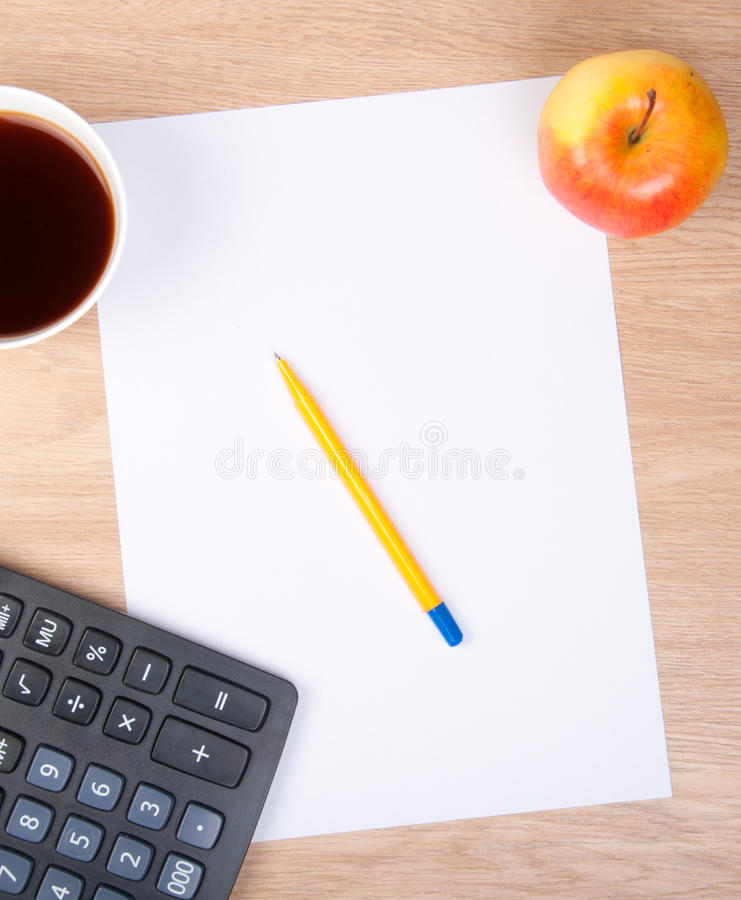 Pen on a white sheet of paper with apple royalty free stock image