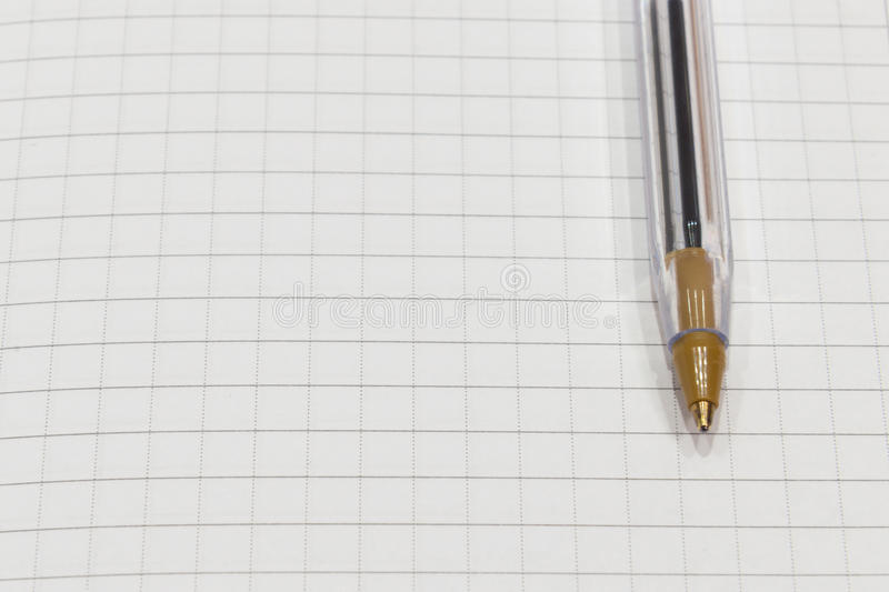 Pen on a white sheet of paper in the cage close up stock images