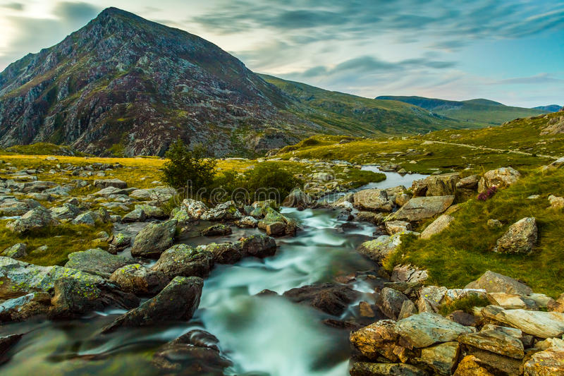 Pen yr Ole Wen and mountain stream in Snowdonia National Park Wales. royalty free stock image