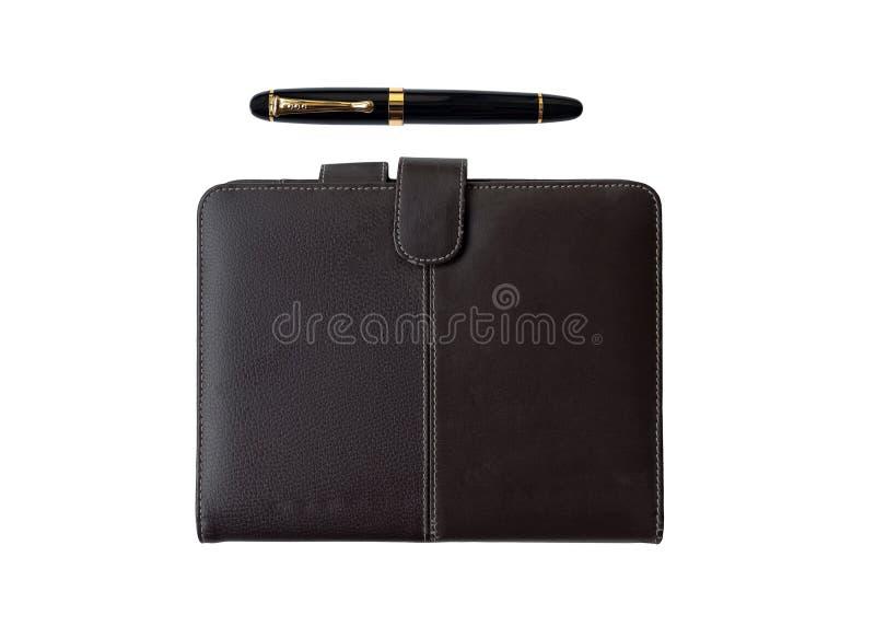 Pena de couro da tampa e de fonte do diário de Brown fotografia de stock royalty free