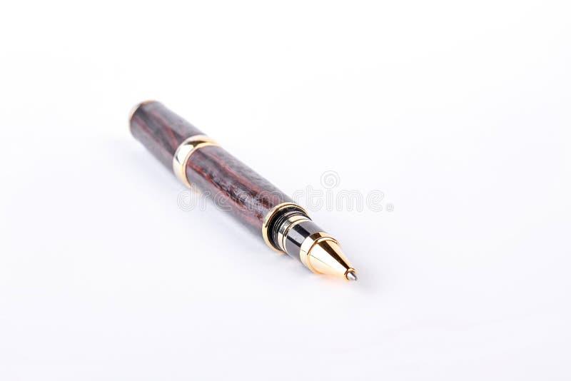 Pena de esferográfica elegante no fundo branco imagem de stock royalty free
