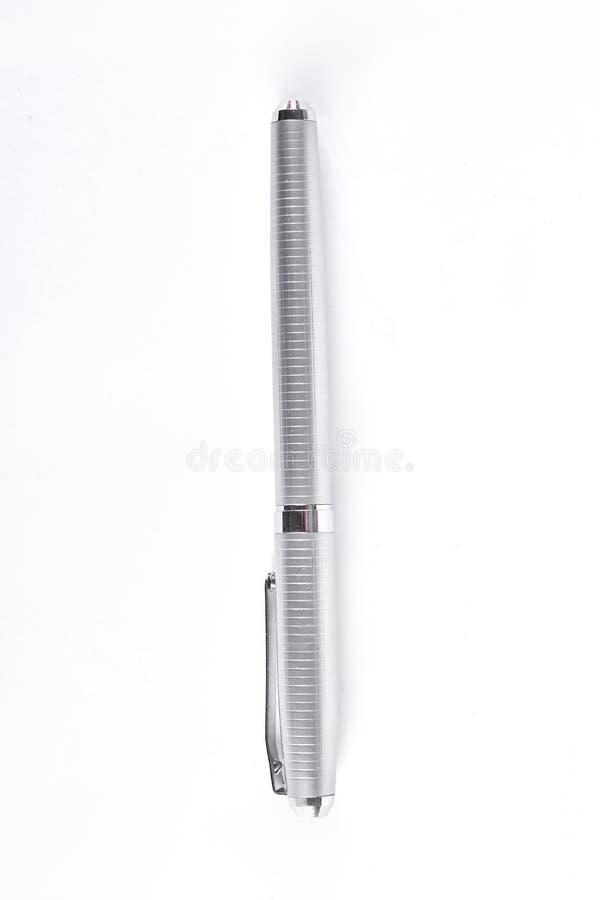 Pena de esferográfica de prata no fundo branco fotografia de stock royalty free