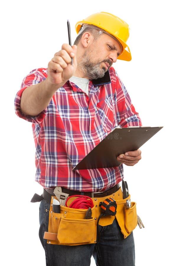 Pena de terra arrendada do construtor acima como não perturbe o sinal imagem de stock royalty free