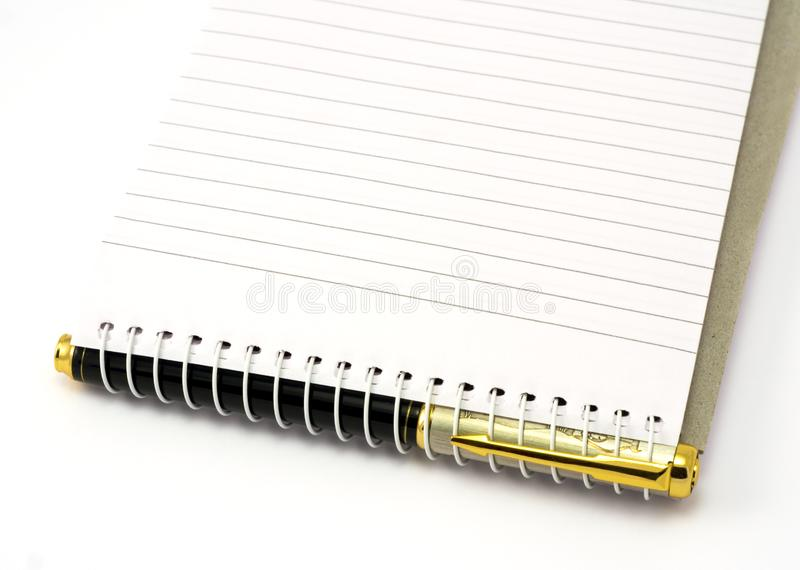 Pena e bloco de notas fotografia de stock