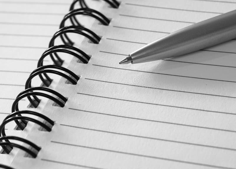 Pena e caderno de bola fotos de stock