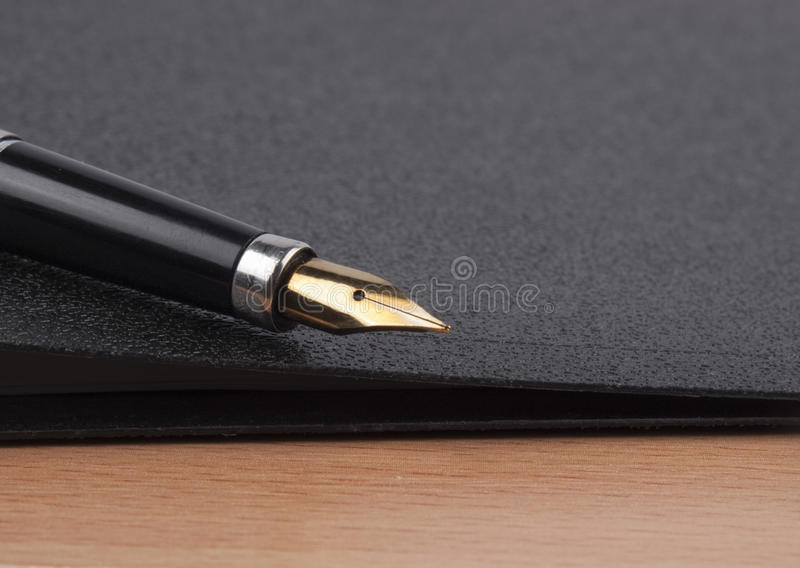 Pena e dobrador preto imagem de stock