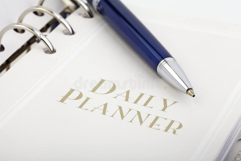 Pena e planejador diário fotos de stock