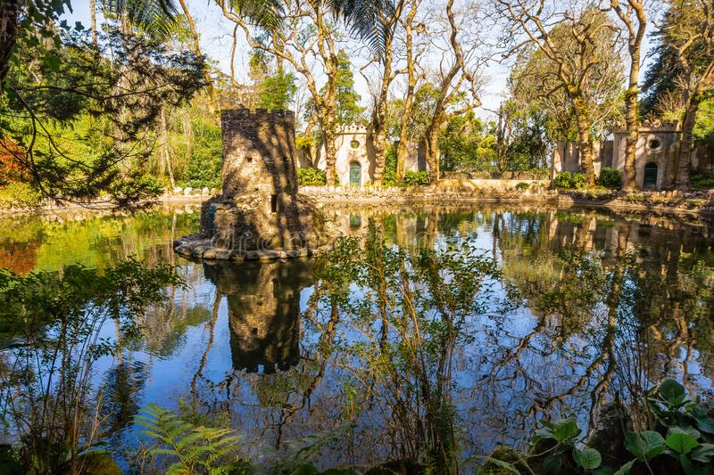 Pena gardens in historical town Sintra in Portugal. Beautiful pond in the Pena park near the Pena National Palace. Sintra, Portugal, lake, garden, architecture stock image