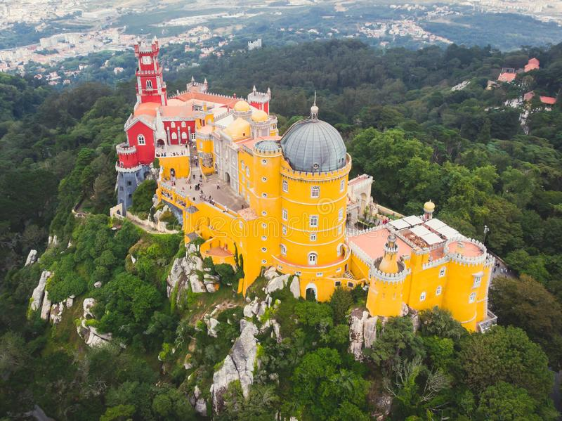 The Pena Palace, a Romanticist castle in the municipality of Sintra, Portugal, Lisbon district, Grande Lisboa, aerial view, shot. From drone stock image