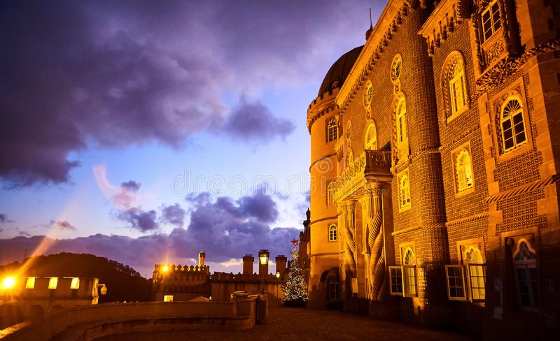 Pena Palace in Sintra, Lisbon, Portugal in the night lights. Famous landmark. Most beautiful castles in Europe. Pena Palace in Sintra, Lisbon, Portugal in the stock photo
