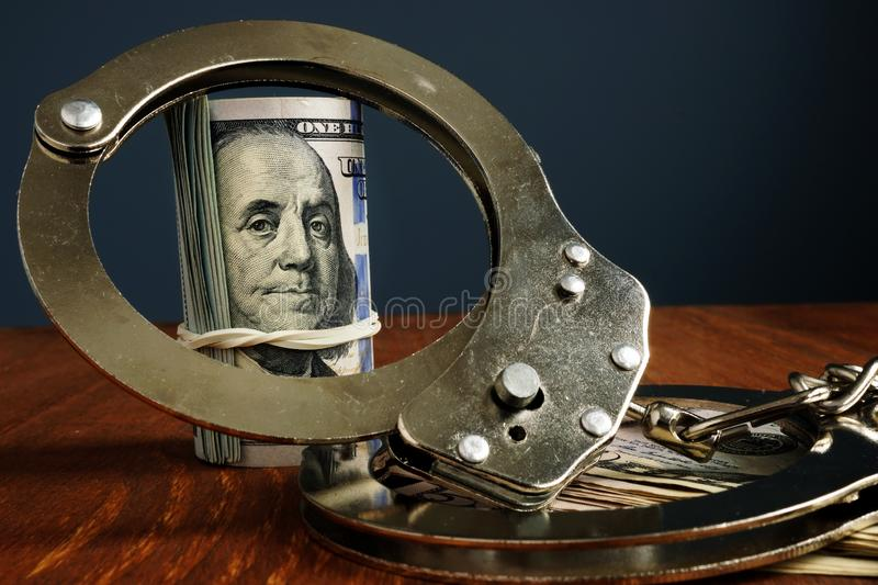 Penalty or bail bond. Money and handcuffs royalty free stock photos