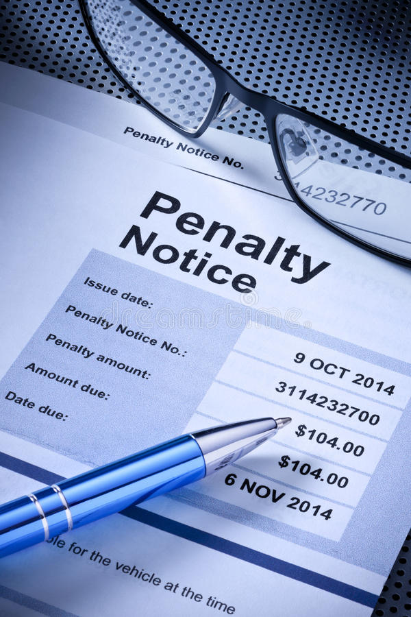 Penalty Notice Parking Ticket. A parking ticket penalty notice with glasses and pen stock photo