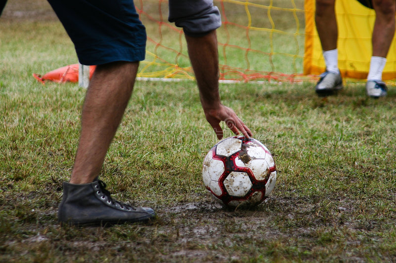 Penalty - positioning. A penalty preparation on an amateur wet match royalty free stock photos