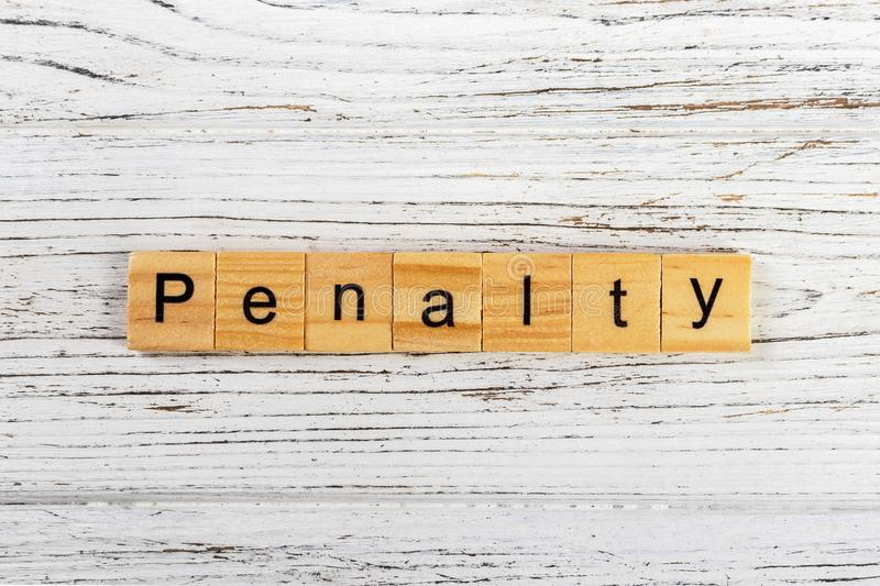 Penalty word made with wooden blocks concept.  royalty free stock image