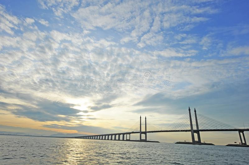 Penang Bridge. The Penang Bridge, route, is a 13.5-kilometre dual carriageway toll bridge and controlled-access highway in the state of Penang, Malaysia. The stock image