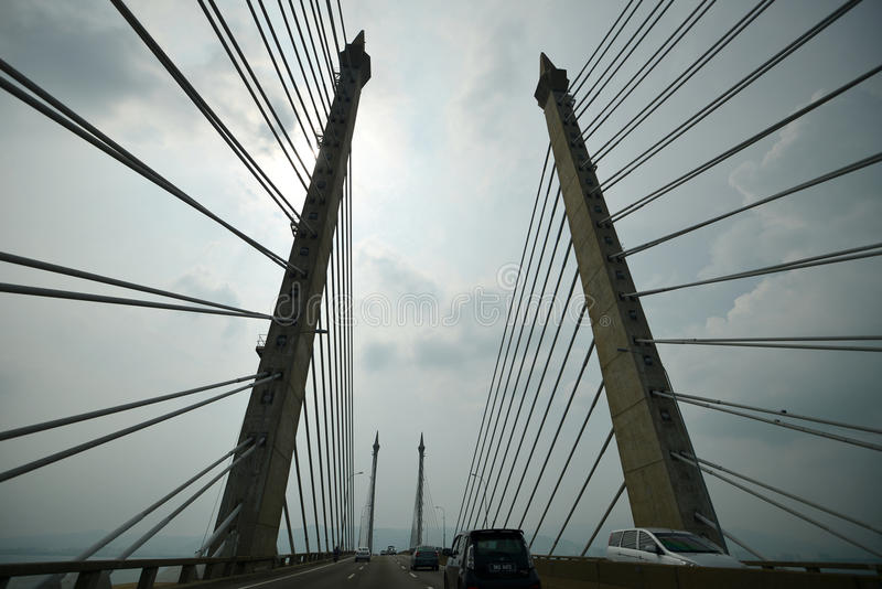 Penang Bridge, Penang,Malaysia. The Penang Bridge, route E36, is a 13.5-kilometre 8.4-mile dual carriageway toll bridge and controlled-access highway in the stock photography