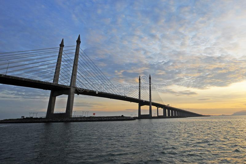 PENANG BRIDGE. The Penang Bridge, route, is a 13.5-kilometre dual carriageway toll bridge and controlled-access highway in the state of Penang, Malaysia. The stock photo