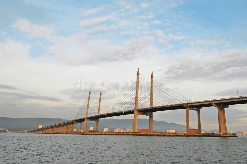 PENANG BRIDGE. The Penang Bridge, route, is a 13.5-kilometre dual carriageway toll bridge and controlled-access highway in the state of Penang, Malaysia. The stock images
