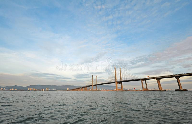 Penang Bridge. The Penang Bridge, route, is a 13.5-kilometre dual carriageway toll bridge and controlled-access highway in the state of Penang, Malaysia. The royalty free stock photo
