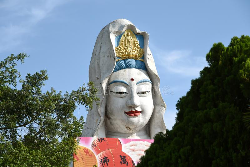 Penang, Malaisie : Guan Yin Buddha au temple photographie stock libre de droits
