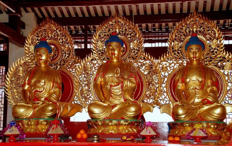 Penang, Malaysia: Three Gilded Buddhas at Chinese Temple. Penang, Malaysia: Three gilded seated Buddhas inside a prayer pavilion at the Taoist Tien Gong Tan royalty free stock photography