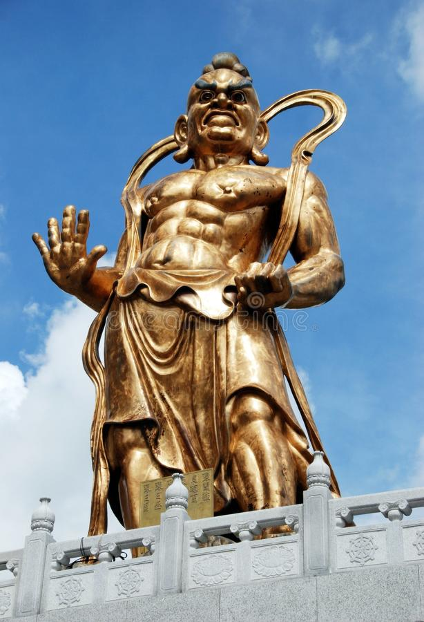 Penang, Malaysia: Warrior Statue. One of the two monumental guardian statues at Kuan Yin Way Place, Hung Ha Er Chiang, at 1891 Kek Lok Si Temple on Penang Island stock image