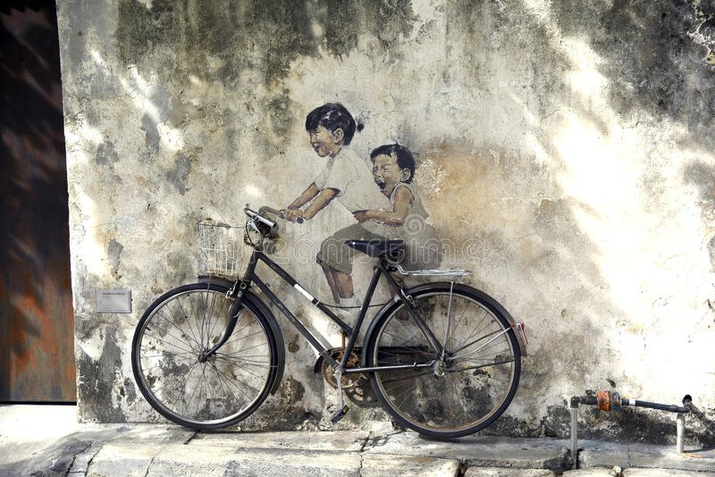 Penang street art - kids on bicycle stock photography