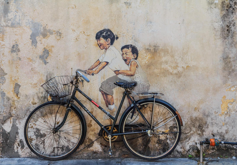 Penang wall artwork. Georgetown, Penang, Malaysia - August 23, 2013: Wall artwork named Little Children on a Bicycle in Penang Georgetown UNESCO heritage zone by stock illustration