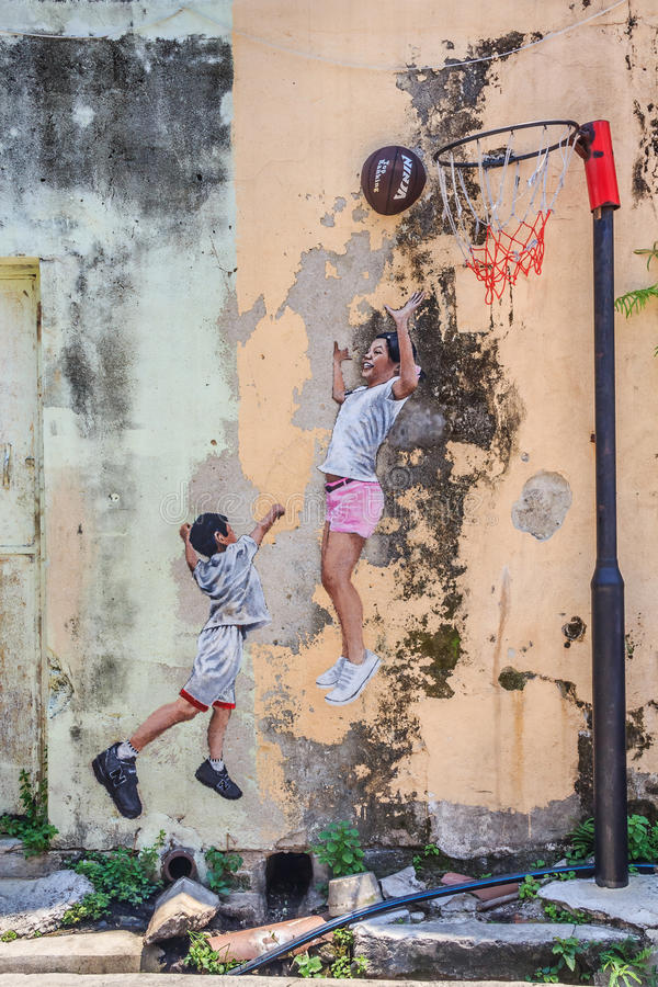 Penang wall artwork named Children Playing Basketball. Georgetown, Penang, Malaysia - August 23, 2013: Wall artwork named Children Playing Basketball in Penang stock illustration