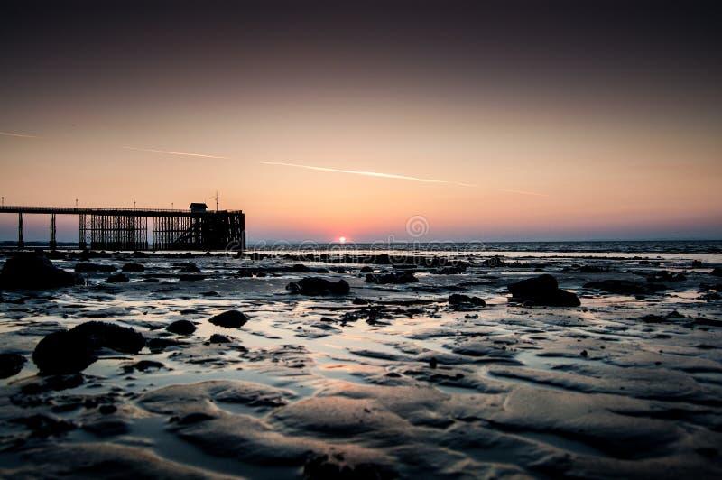 Penarth-Strand Pier Sun Rise lizenzfreie stockbilder