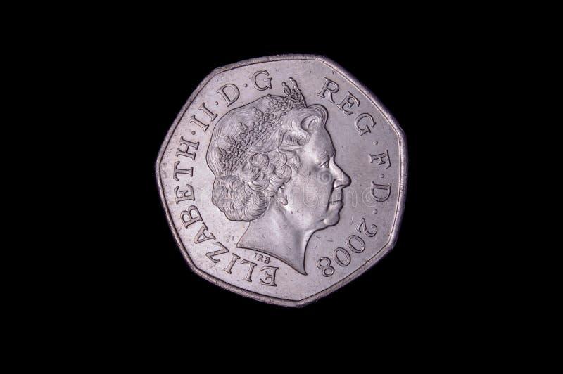 50 pence Britse muntstuk met Elizabeth II stock foto's
