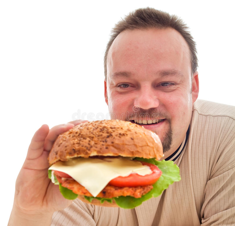 Penchant de nourriture - homme dans la phase de démenti image stock