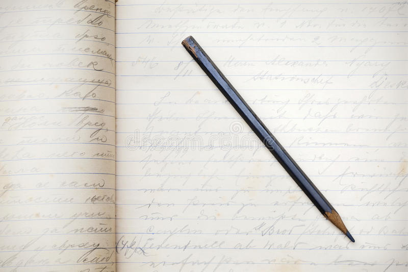 Pencil. A graphite pencil on a handwritten pages royalty free stock photo