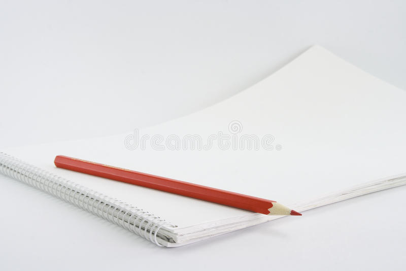 A pencil on an album royalty free stock photography