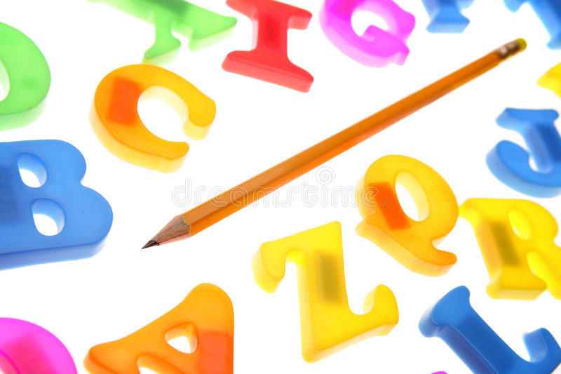 Pencil & alphabet. Pencil and alphabet letters over white stock photography