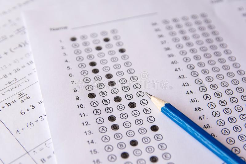 Pencil on answer sheets or Standardized test form with answers b stock images