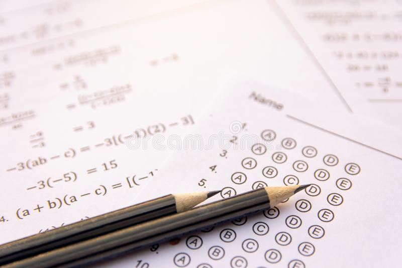Pencil on answer sheets or Standardized test form with answers bubbled. multiple choice answer sheet royalty free stock photo