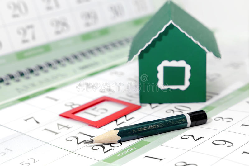 Pencil on the background of a cardboard green house stock image