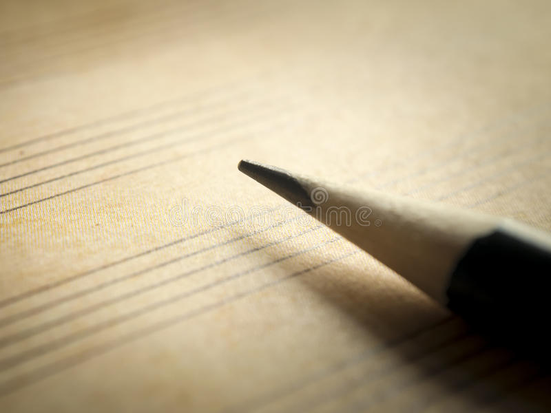 Pencil and blank sheet music notation royalty free stock image