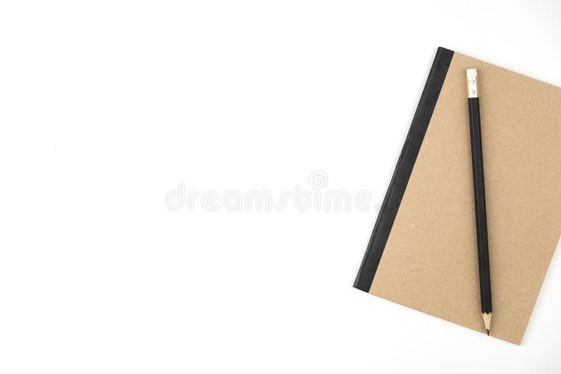 Pencil on book of brown on white isolated background. Copy space royalty free stock photo