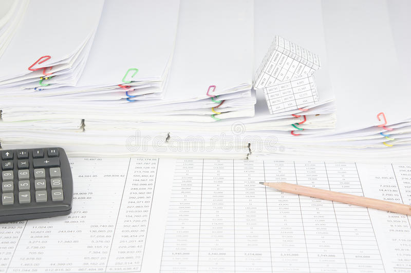 Pencil and calculator have house on step pile of paperwork royalty free stock image
