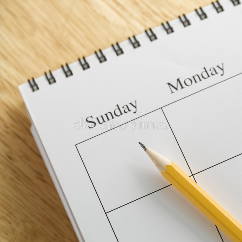 Pencil on calendar. stock images