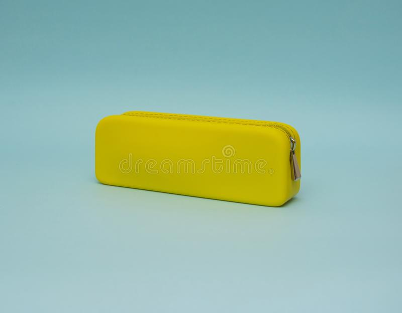 Pencil case isolated on the blue background stock photo