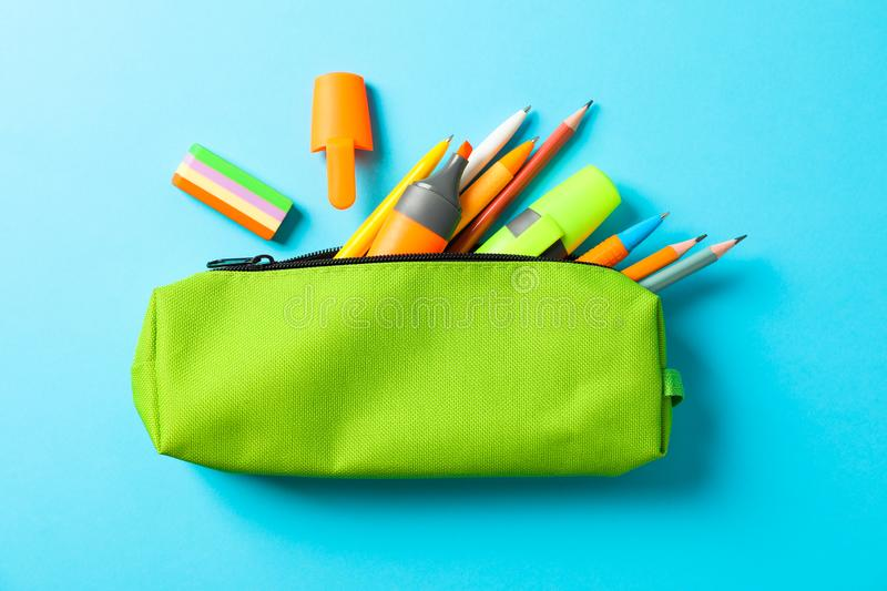 Pencil case with school supplies on blue background. Space for text stock photo