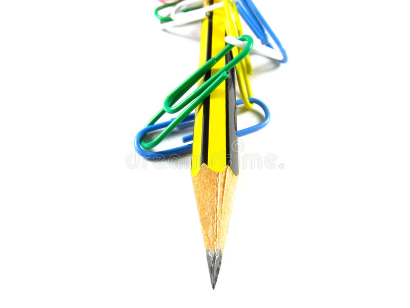 Pencil in chains of paper clips royalty free stock images