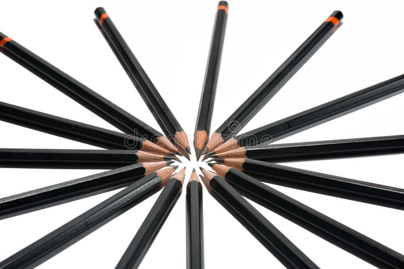 Pencil Circle-from angled above. Macro picture of black pencils on a white background from above stock images