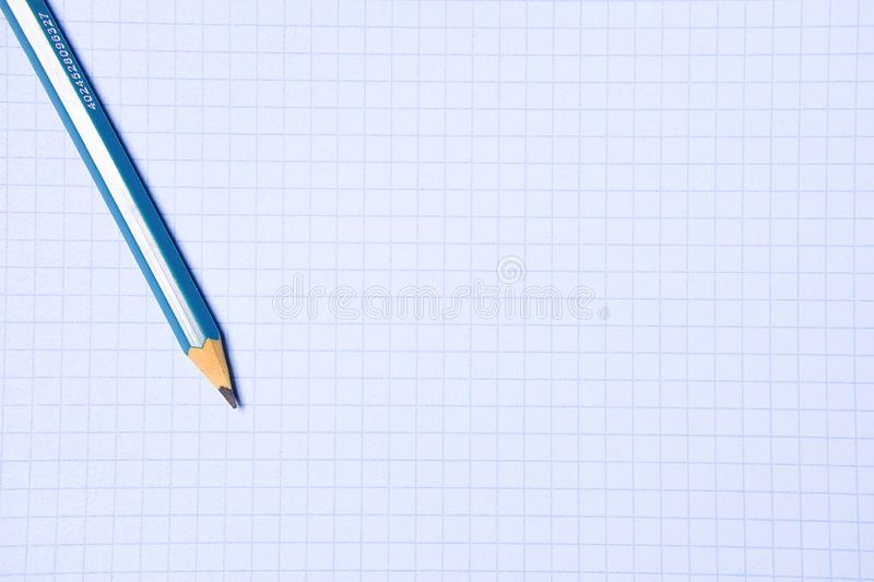 Pencil on a clean white paper sheet. The concept of education, business, entrepreneurship. Copy space stock images