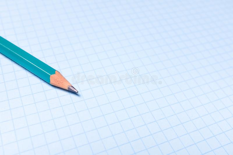 Pencil on a clean white paper sheet. The concept of education, business, entrepreneurship. Copy space stock image