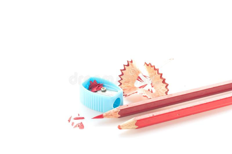 Pencil crayon and sharpener on white background. royalty free stock photography